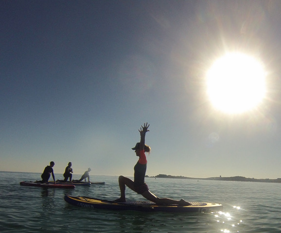 Wellness Holidays To Guernsey - Yoga on SUP